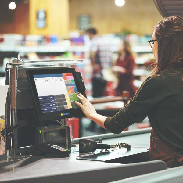 Cashier Using Traditional Point of Sale Software